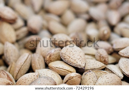 closeup of a pile of almonds in shell