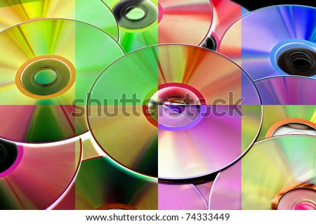 closeup of a pile of CD, CD-ROM and DVD