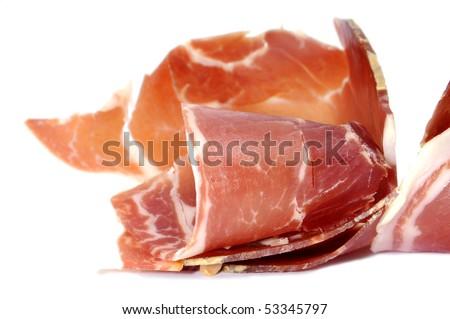 closeup of a pile of jamon serrano, spanish ham