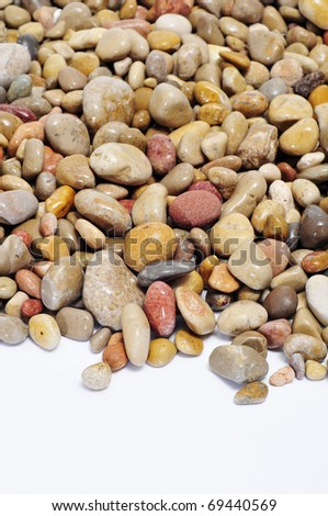 closeup of a pile of pebbles on a white background