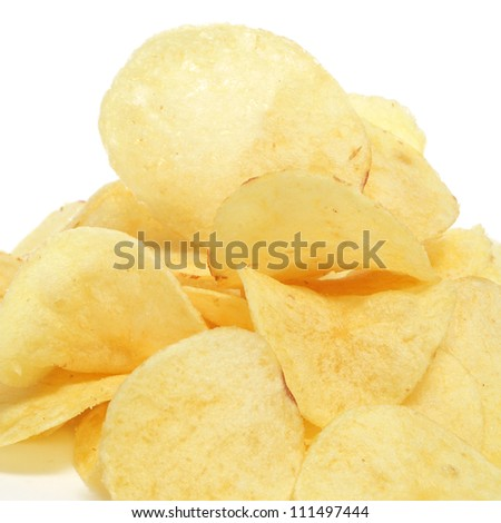 closeup of a pile of potato chips on a white background