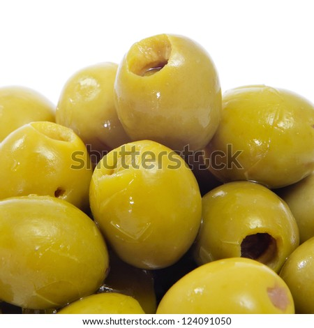 closeup of a pile of spanish olives tapas on a white background