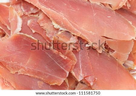 closeup of a pile of spanish serrano ham