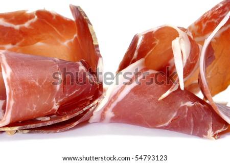 closeup of a pile of spanish serrano ham slices - stock photo