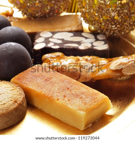 closeup of a pile of turron, mantecados and polvorones, typical spanish christmas sweets