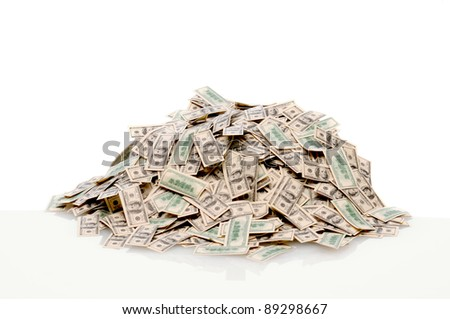 Closeup of a pile of USA hundred dollar bills on white with reflection. - stock photo