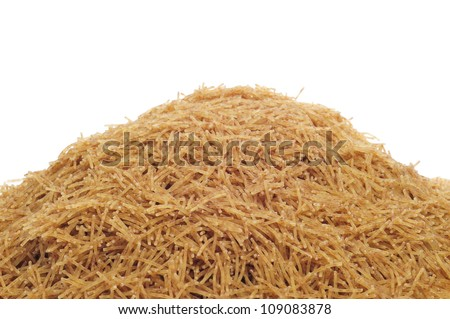 closeup of a pile of whole wheat noodles on a white background #109083878