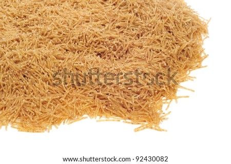closeup of a pile of whole wheat noodles on a white background #92430082