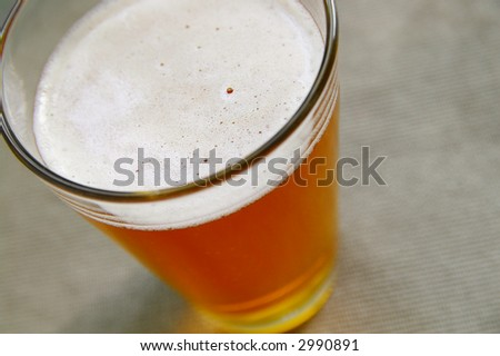 Closeup of a pint of beer from above