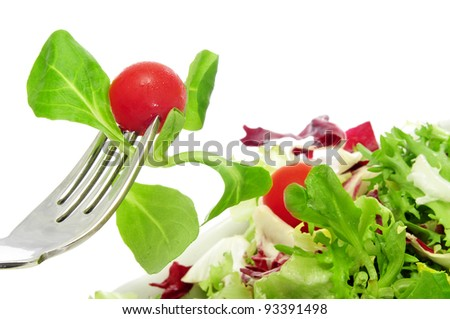 closeup of a plate of salad with cherry tomatoes