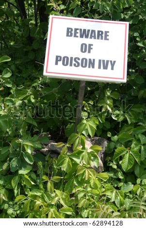 Closeup of a poison ivy warning sign