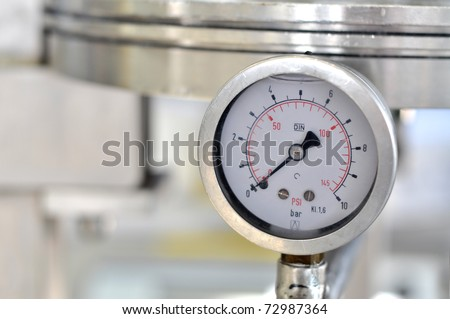 Closeup of a pressure meter on a machine