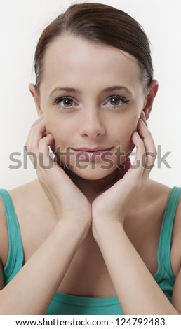 Closeup of a pretty young woman with a great smile  on white background