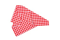 Closeup of a red and white checkered napkin or tablecloth isolated on white background. Kitchen accessories.