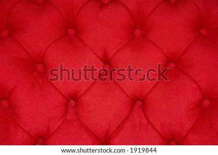 Closeup of a red cushion with buttons