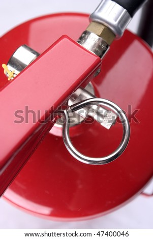 Closeup of a red fire extinguisher.