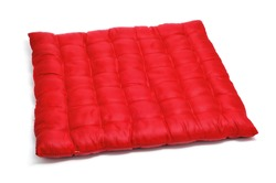 closeup of a red satin cushioned on a white background