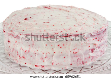 closeup of a red velvet cake with pink frosting isolated over white - stock photo