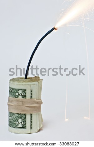 Closeup of a roll of dollar bills attached to a burning fuse on a white background, resembling a bomb made of dollar bills (http://www.artistovision.com/metaphors/dollar-bomb-white-bg-closeup.html).