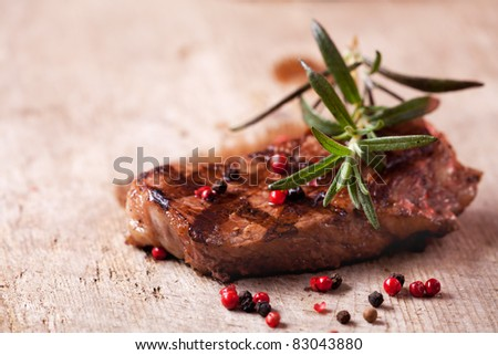 closeup of a rosemary leaf on a steak