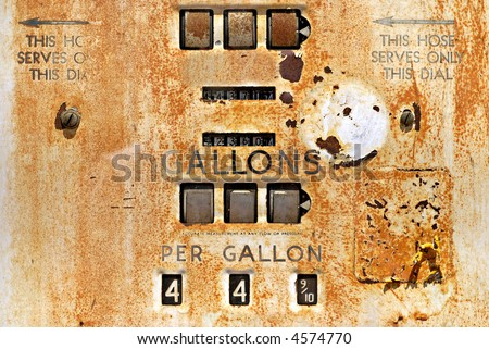 Closeup of a rusty old gas pump from the 1940s - stock photo
