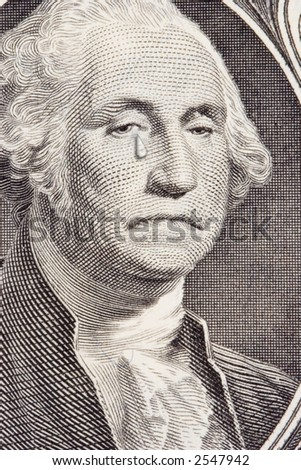 Closeup of a saddened George Washington on the one dollar bill.  George has a tear streaming down the right cheek.  Metaphor for the poor performance of the US Dollar. - stock photo