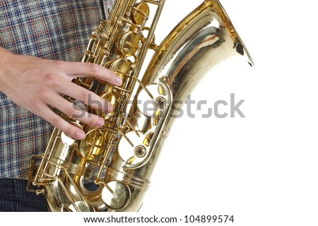 Closeup of a saxophone as a man is playing on it, sideview - isolated on white