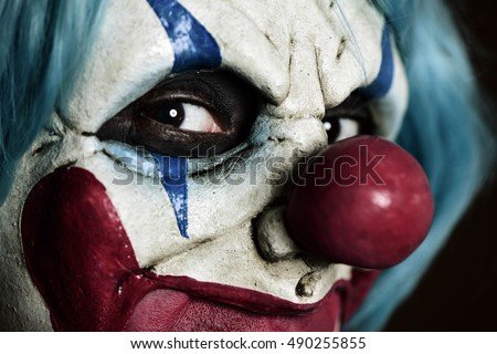 Photo of  closeup of a scary evil clown