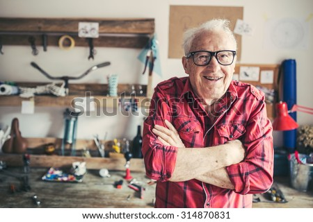 Closeup of a senior craftsman in his workshop