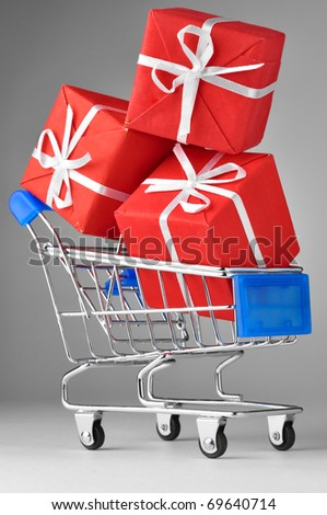 closeup of a shopping cart with gifts