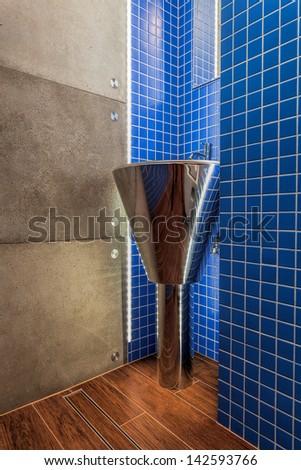 Closeup of a silver modern washbasin in a bathroom
