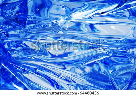 closeup of a smashed plastic bottle with water inside