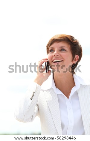 Closeup of a smiling businesswoman talking on the phone