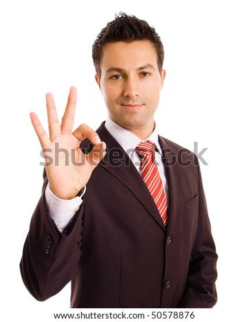 Closeup of a smiling young business executive gesturing an excellent job