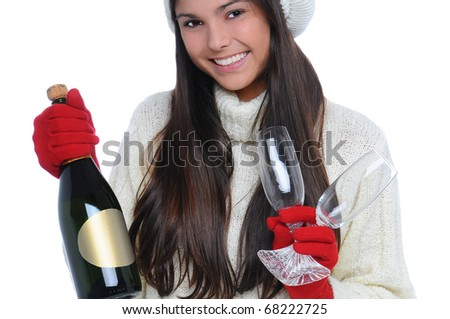 Closeup of a smiling young woman holding a bottle of champagne and two crystal flutes ready to celebrate Valentines Day. Horizontal Format isolated on white.