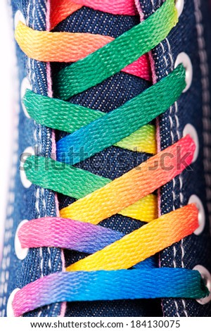 Closeup of a sneaker with colored shoelaces, abstract background #184130075