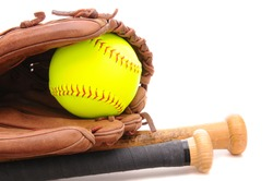 Closeup of a Softball Glove ball and two bats on white with copy space. Horizontal format.