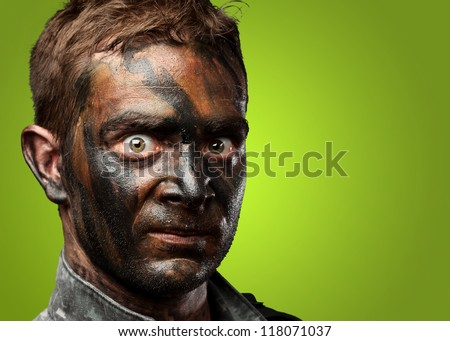 Closeup of a soldier against a green background
