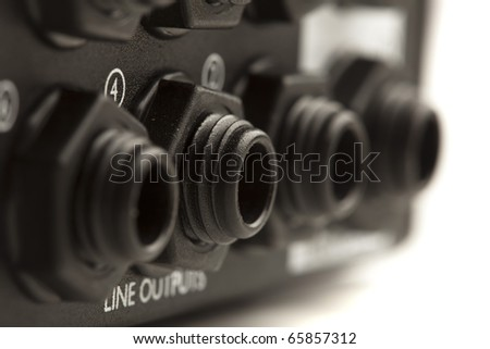 closeup of a sound card input on white background