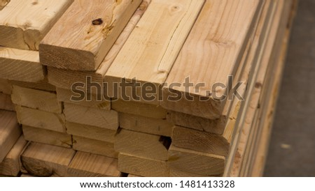 Closeup of a stack of pine planking ready to be used for construction