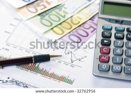 Closeup of a stock chart with Euro banknotes, calculator and pen