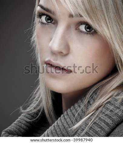 Closeup Of A Sweet Blond Girl With A Big Warm Collar Around Her Neck