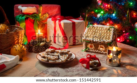 Closeup of a table set with Christmas gifts