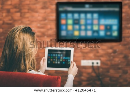 Closeup of a tablet is connected to a smart TV.
