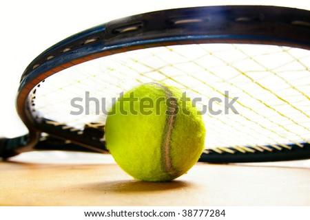 closeup of a tennis racket and tennis-ball