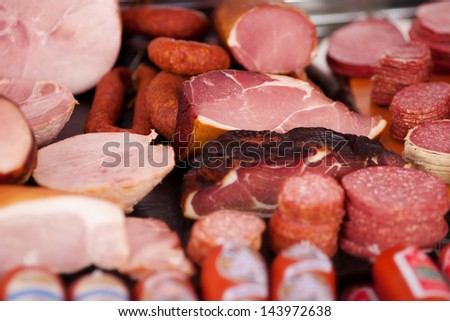 Closeup Of A Variety Of Cooked Meats, Salamis And Sausages At A Delicatessen