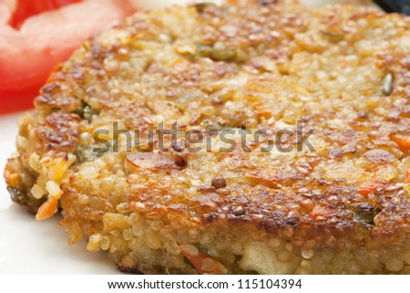 Closeup of  a vegetarian quinoa burger.