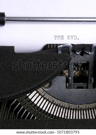 "Closeup of a vintage typewriter with ""the end"" typed on the paper.        #1071803795"