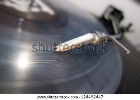 Closeup of a vinyl record and needle