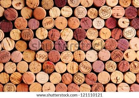 closeup of a wall of used wine...
